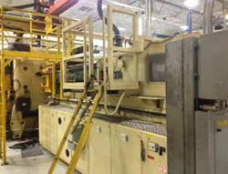 A used 1815 ton Husky plastic molding machine for sale