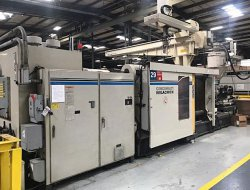 Photo of a 1000 ton Cinci Milacron plastic molder from 1996.