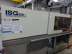 Photo of a used 250 ton Toshiba plastic injection molding machine from 1999