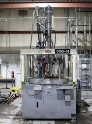 A 2000 165 ton Nissei vertical plastic molder with a  rotary table
