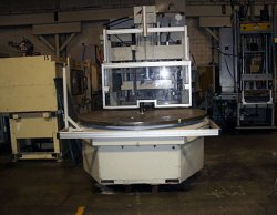 Used 130 ton Autojectors vertical molder with a large rotary table that was made in 2000