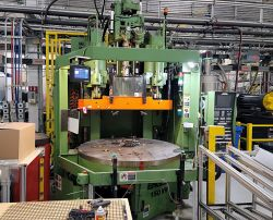 A picture of our 150 ton Engel vertical used injection molder for sale