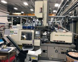 65 ton Toshiba all-electric two shot injection molder for sale from 2001