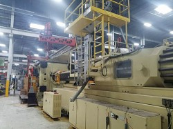 Two 2500 ton Husky used injection molders for sale from 2002