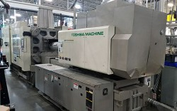 Photo of one of the used 500 ton Toshiba electric injection molders for sale