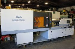 A full view of a 2000 200 ton Toyo used plastic injection molder